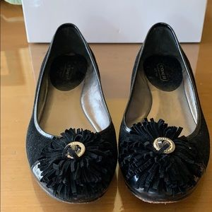 Lightly worn black suede flats with button pompon
